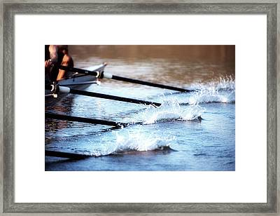 Sculling Team Rowing On Water Framed Print