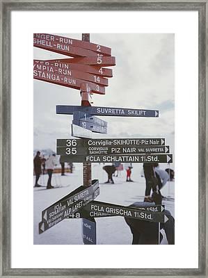 Signpost In St. Moritz Framed Print by Slim Aarons