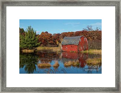 Sinking Red Barn In Fall Framed Print