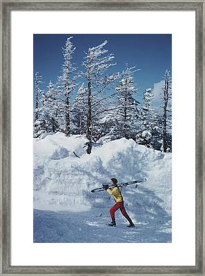 Skier In Vermont Framed Print by Slim Aarons