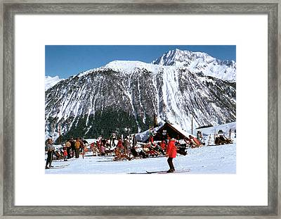 Skiing At Courcheval Framed Print by Slim Aarons