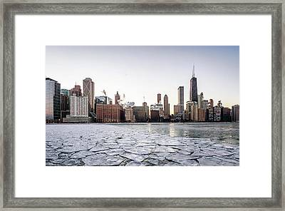 Skyline And Cracks In The Water Framed Print