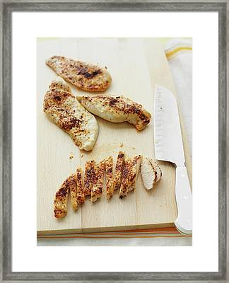 Sliced Chicken Breast On Wooden Board Framed Print by Cultura Rm Exclusive/brett Stevens
