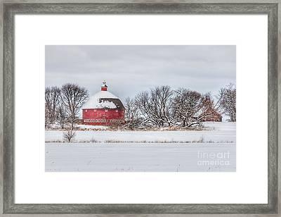 Snow Covered Round Barn Framed Print