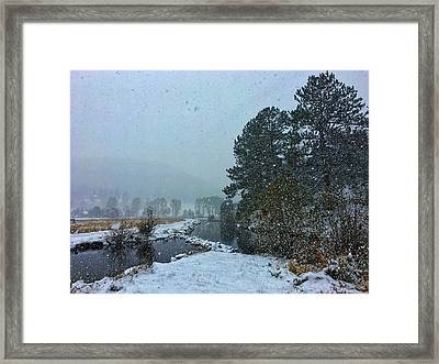 Framed Print featuring the photograph Snowstorm At The Lake by Dan Miller