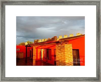 Framed Print featuring the photograph Storm Brewing, Sun Setting by Rosanne Licciardi