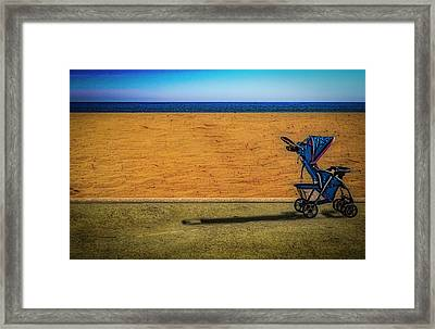 Stroller At The Beach Framed Print
