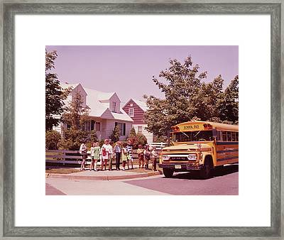 Students Waiting To Board Bus Framed Print by H. Armstrong Roberts