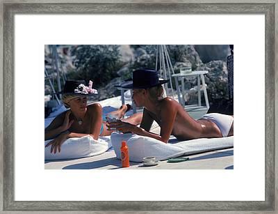 Sunbathing In Antibes Framed Print by Slim Aarons