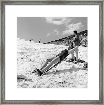 Sunbathing Skier Framed Print