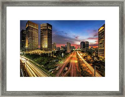 Sunset In Jakarta Framed Print by The Trinity