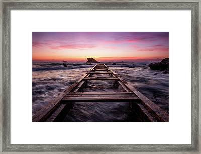 Sunset Shining Over A Wooden Pier In Livorno, Tuscany Framed Print