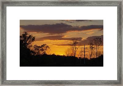 Sunset With Electricity Pylon Framed Print