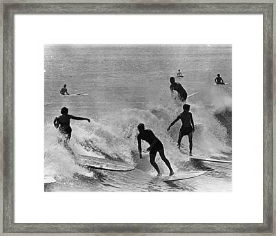 Surfing Derby Framed Print