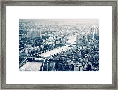 The Bisection Of Saigon Framed Print