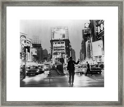 Traffic In Times Square Framed Print by Fpg