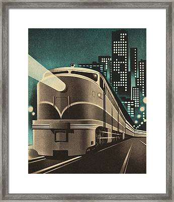 Train Leaving City Framed Print