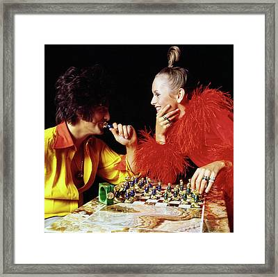 Twiggy And Justin De Villeneuve Play Chess, Vogue Framed Print by Bert Stern