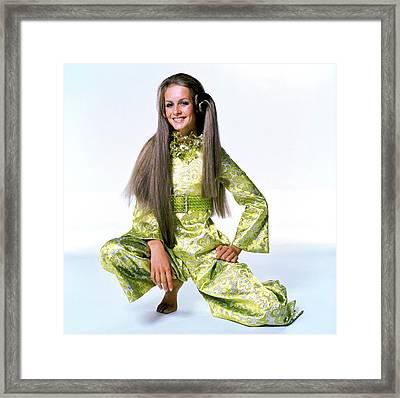 Twiggy In Green Brocade Framed Print by Bert Stern