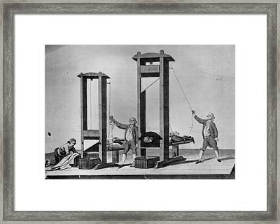 Twin Guillotines Framed Print by Hulton Archive