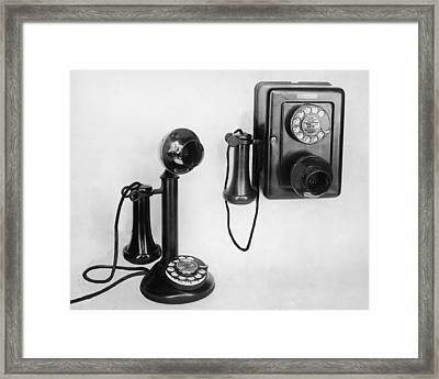 Two Old-fashioned Telephones Framed Print by Authenticated News
