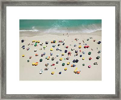 Umbrella Pattern On Beach Framed Print