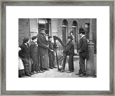 Victorian Busker Framed Print by John Thomson