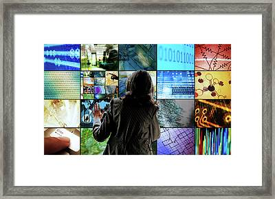 Woman Touching Screens Framed Print by Richard Newstead
