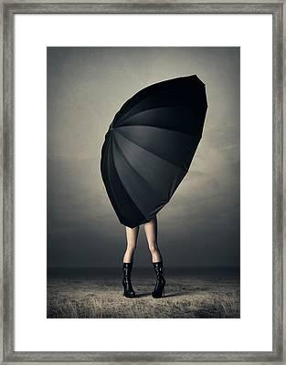 Woman With Huge Umbrella Framed Print