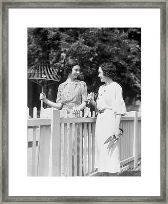 Women Chatting Over Fence Framed Print by H. Armstrong Roberts