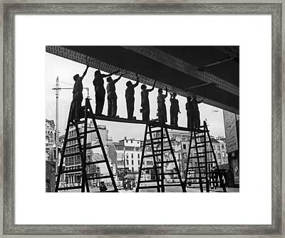 Women Paint Bridge Framed Print by Harry Shepherd