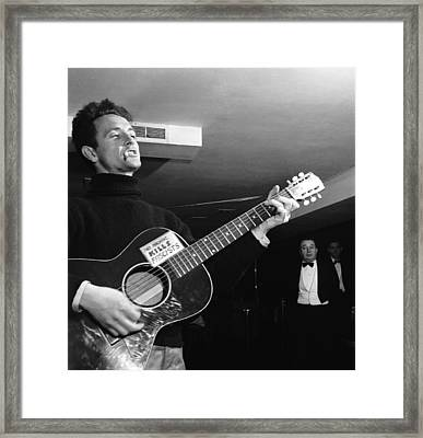 Woody Guthrie Plays Framed Print