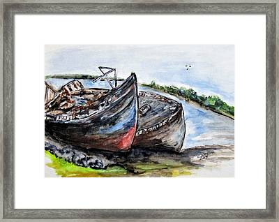 Wrecked River Boats Framed Print