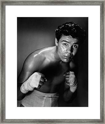 Young Adult Man In A Fighting Stance Framed Print by Superstock