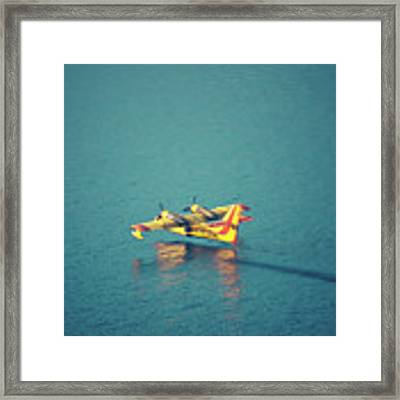 Aircraft Firefighter Take Water In The Sea Framed Print by Raimond Klavins