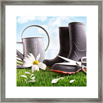 Boots With Watering Can And Daisy In Grass  Framed Print