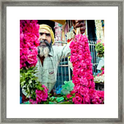 Man With Flowers Near The Temple Kerala Yatra 2016 Yantra Framed Print by Raimond Klavins