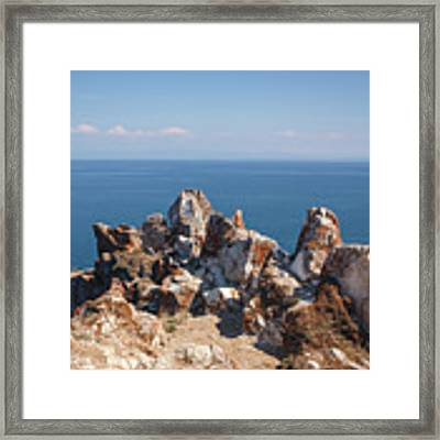 Red Rocks On Blue Sky And Water Background Framed Print by Sergey Taran