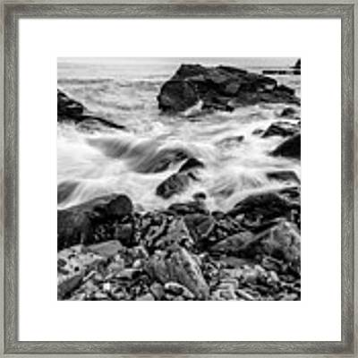 Waves Against A Rocky Shore In Bw Framed Print by Doug Camara