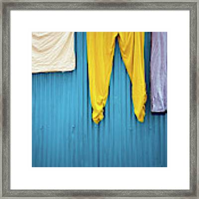 Colorful Laundry Framed Print by Nicole Young