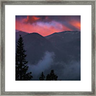 Sunset Storms Over The Rockies Framed Print by John De Bord