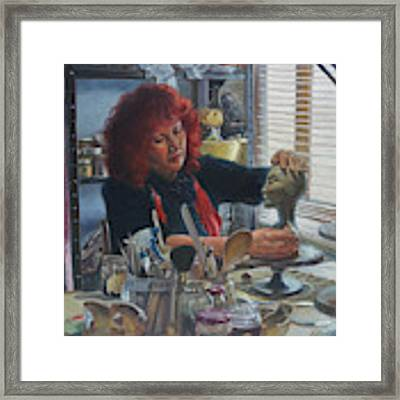 Woman Ceramicist At Work In Her Studio Framed Print by Martin Davey
