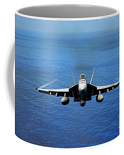 Coffee Mug featuring the photograph  A Fa-18 Hornet Demonstrates Air Power. by Paul Fearn