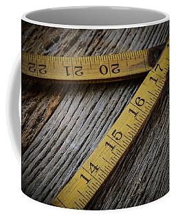 Old Tape Measure On Rustic Wood Background Coffee Mug