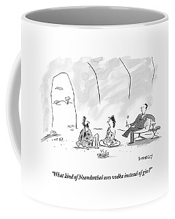 A Caveman And Cavewoman Sit On The Floor Coffee Mug