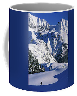 A Female Snowboarder Hiking Coffee Mug