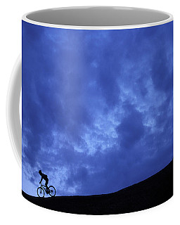 A Silhouette Of A Woman Mountain Biking Coffee Mug