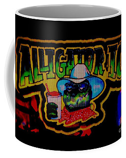 Coffee Mug featuring the photograph Alligator Ice by Kelly Awad