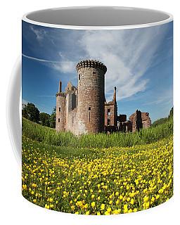 Coffee Mug featuring the photograph Caerlaverock Castle by Maria Gaellman