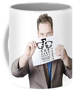 Mature Man Holding Glasses And Eye Checking Chart Coffee Mug